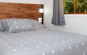 Paperbark Cottage Main Bedroom with linen, blankets and pillows for a comfortable sleep