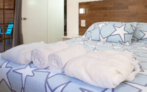 Paperbark Cottage Second Bedroom with fluffy bathrobes, towels, linen, blankets and pillows for a comfortable sleep