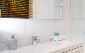 A bathroom with a good comfort level where your rain shower awaits