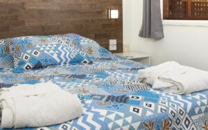 Fluffy bathrobes, towels, linen, blankets and pillows for a comfortable sleep