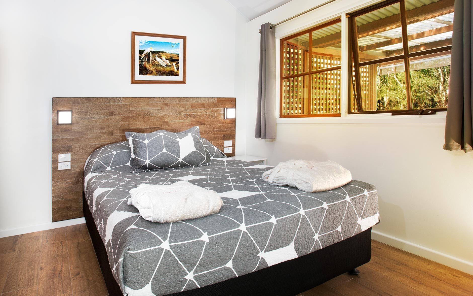 Melaleuca Seaside Retreat - Bluegum Cottage Bedroom View to Window Tight View